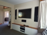 Entertainment Wall with Flush Mounted TV and Speak
